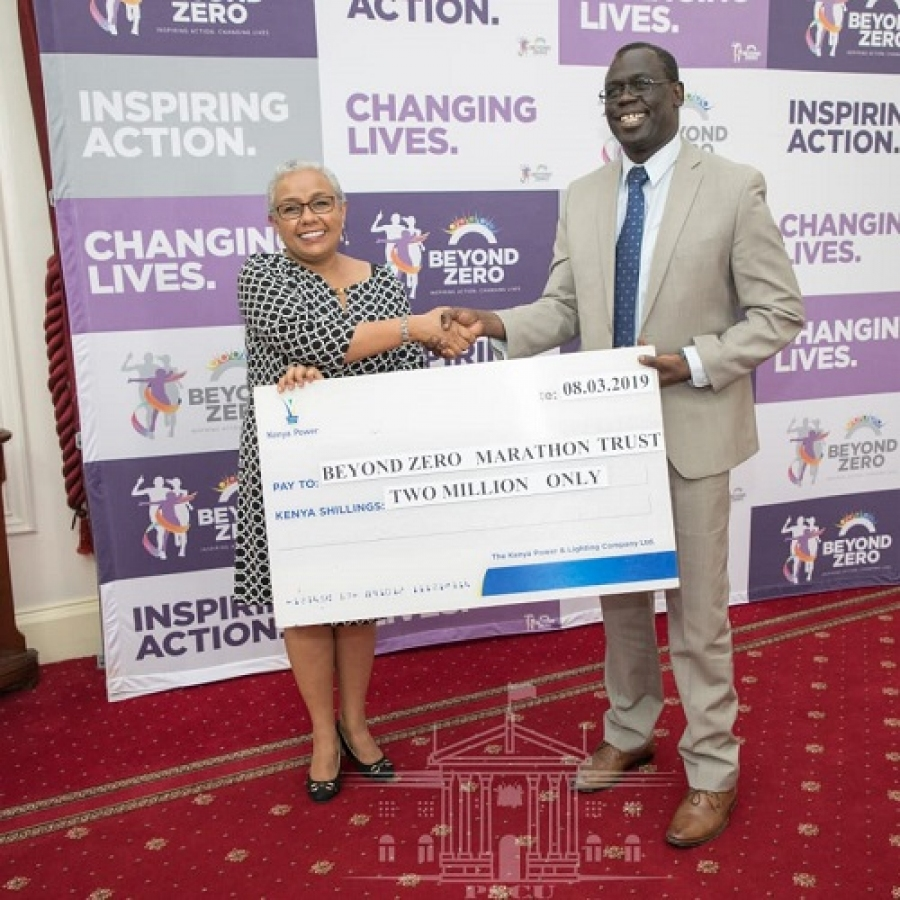 Ag.MD & CEO Eng. Jared Othieno presents a cheque of kshs. 2M sponsorship towards #BeyondZeroCampaign.