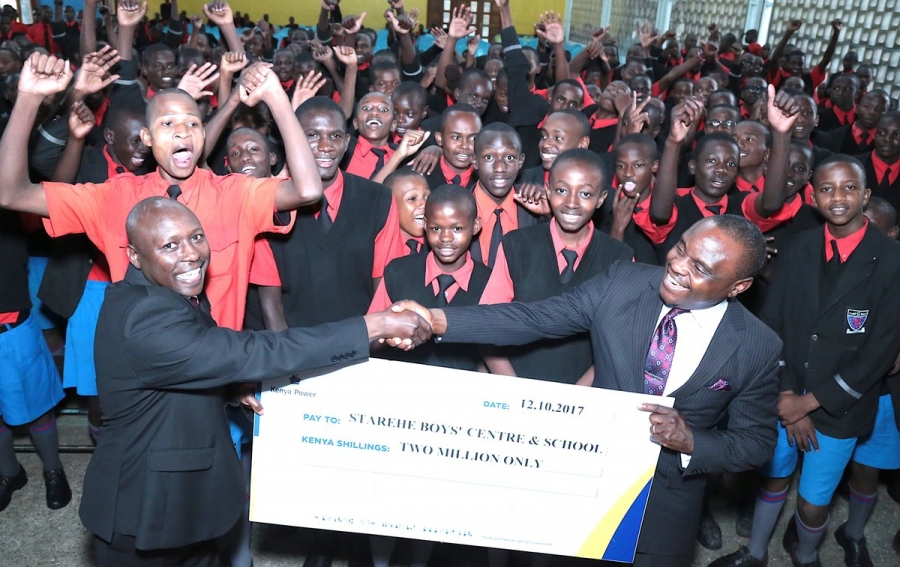 MD & CEO Ken Tarus, PhD presentes a Sh2 million cheque to boost our Education Endowment Fund with Starehe Boys Centre.