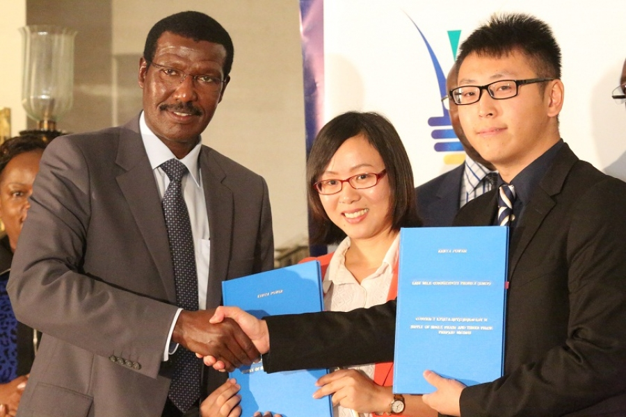 Kenya Power MD & CEO, Dr. Ben Chumo (left), Shenzhen Inhemeter Company Ltd Regional Manager, Salinger Sheng (center) and Wonder Zhou.