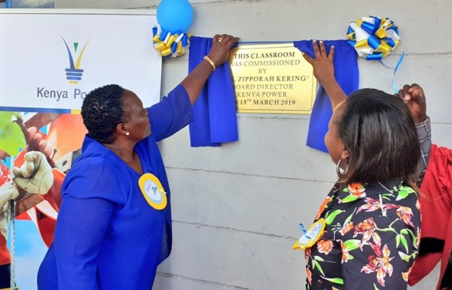 Board member Hon. Zipporah Kering and Ag.GM Corporate Affairs & Company Secretary MS.Imelda Bore Commissioning a form 2 classroom that we have constructed for AIC Cheles mixed secondary school.