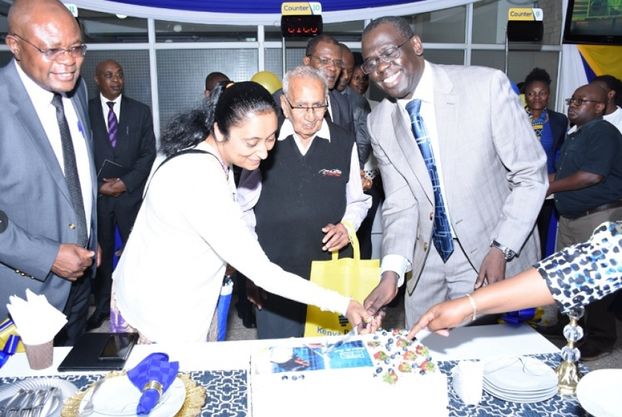 Ag. MD & CEO Eng. Jared Othieno cuts a cake to celebrate Customer Service Week 2019 at Stima Plaza banking hall.