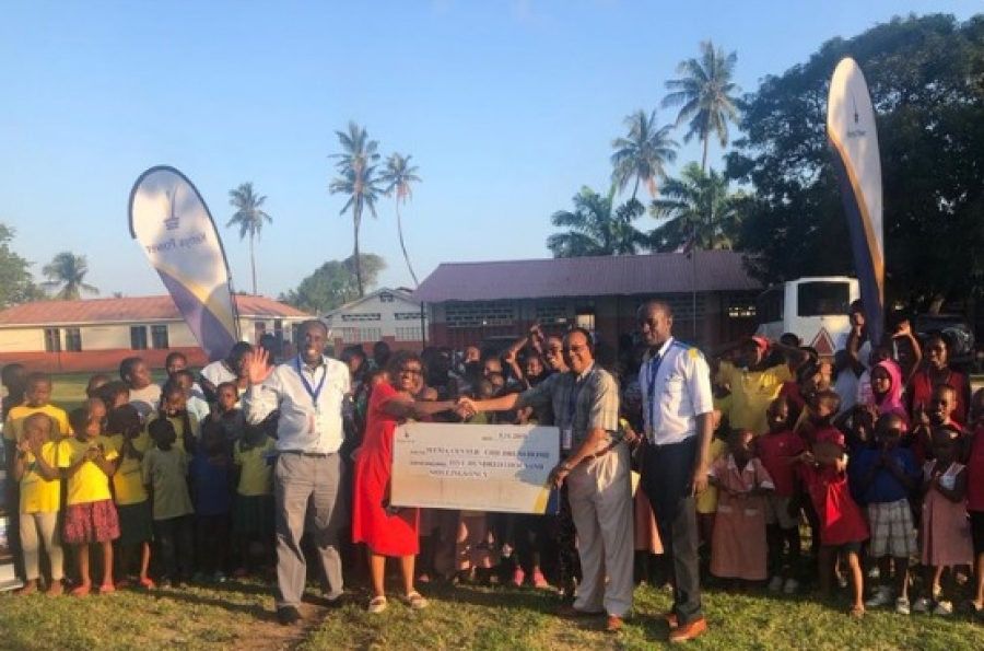 RM, Coast Region Eng. Hezekiah Mwalwala (Second Right) hands over a dummy cheque of Shs.500,000 to Lucy Yinda founder of Wema Children