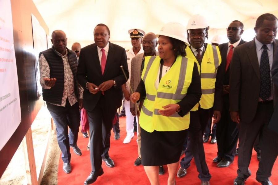 Kengen MD & CEO Rebecca_Miano takes H.E. President Kenyatta through #OlkariaV construction progress as Ag. MD & CEO Eng. Jared Othieno looks on.