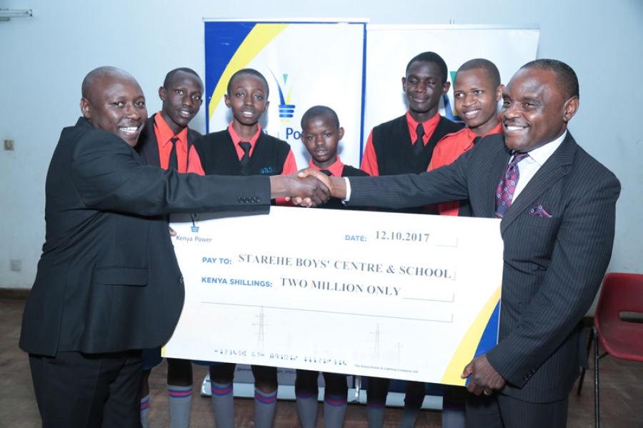 MD & CEO Dr. Ken Tarus hands over a cheque of KSh2 Million to Director of Starehe Boys Mr Charles Masheti #KenyaPowerEndowmentFund.