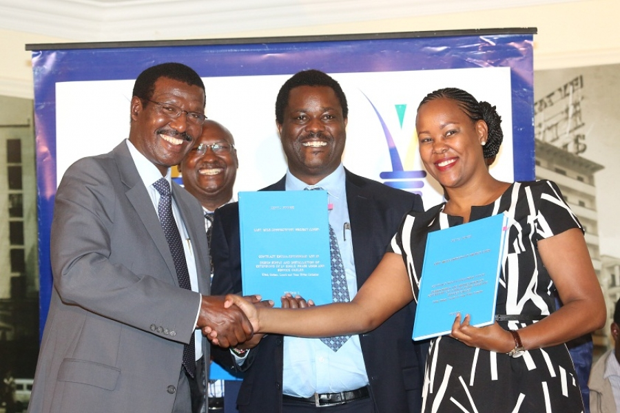 Kenya Power MD & CEO, Dr. Ben Chumo (left), Eng. Vincent Komu and Pauline Wambui of Etrade Company Ltd.