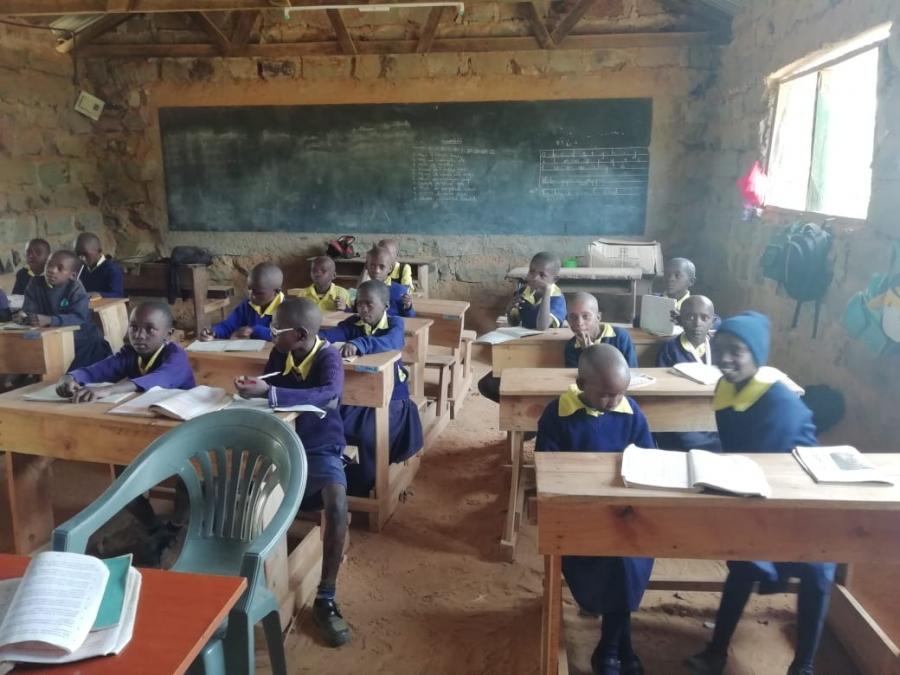 Pupils of Kiamukuyu Primary assembled at their desks provided by Kenya Power as part of Wezesha Jamii programme.
