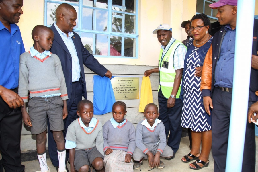 Ag. MD Dr. Ken Tarus pose for a photo with staff and pupils during the commissioning of reconstructed Muvwana Primary School classroom block.