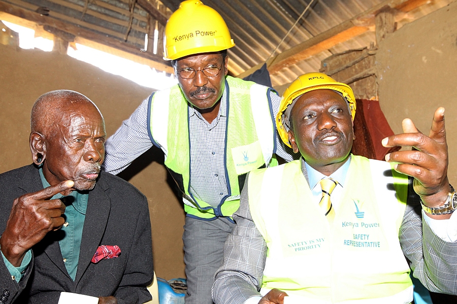 DP William Ruto & former KPLC MD & CEO Dr. Ben Chumo inside the  house of Mzee Samoei Kessem (L) during The Last Mile Connectivity Project  Launch in Solai, Rongai, Nakuru County.