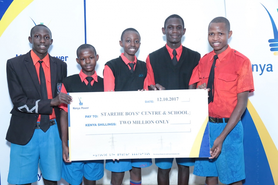Starehe Boys pupils proudly display a cheque of KSh2 Million donate through #KenyaPowerEndowmentFund.