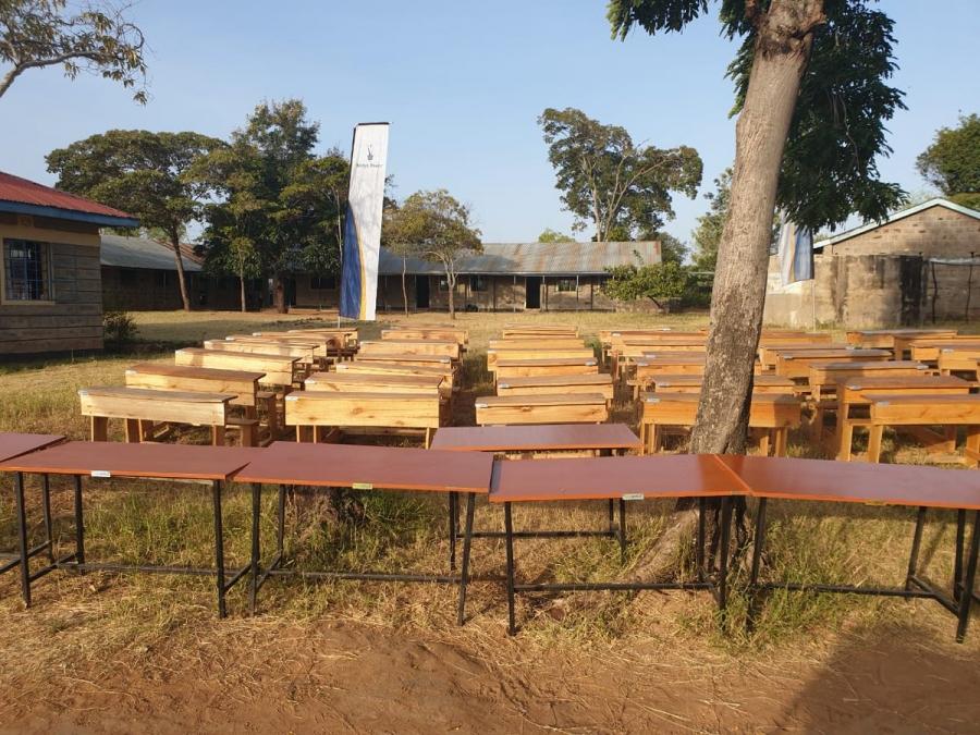 Tables and 60 desks donated to Kiamukuyu Pry under Wezesha Jamii programme.