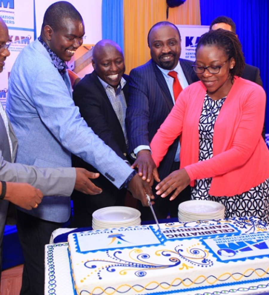 Uasin Gishu County Governor, Jackson Mandago joins MD Dr. Ken Tarus and KAM CEO Phyllis Wakiaga in cutting a cake to celebrate KAM/KP Partnership.