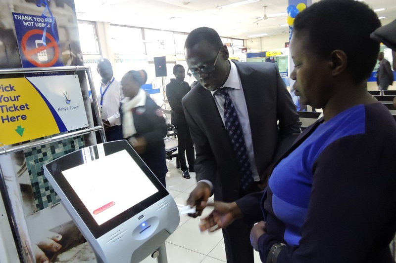Ag. MD & CEO Eng. Jared Othieno serving our customers during the launch of our refurbished Electricity House Customer Service Centre - 24.09.2018