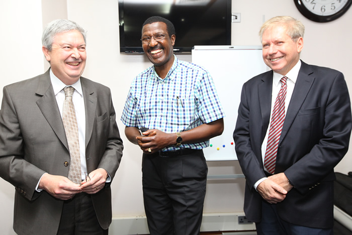 Kenya Power CEO Dr. Ben Chumo with Bamburi Cement MD,Bruno Pescheux and Brenth Hampton when they paid a courtesy call.