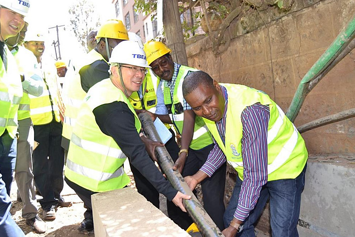 MD &CEO Dr. Chumo joins Kenya Power technicians in laying an underground cable in Parklands.
