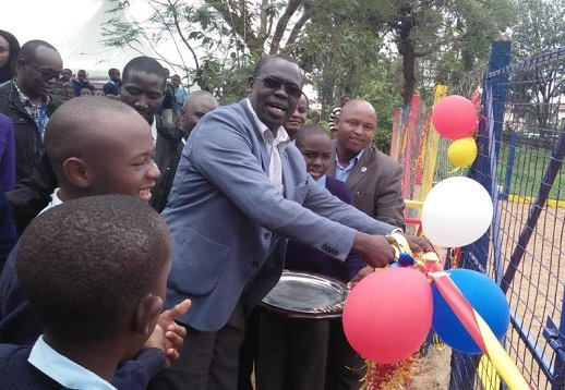 Ag. MD & CEO, Eng. Jared Othieno officially handing over a playground for children with disabilities (autistic children) at City Primary School in Ngara area, Nairobi.