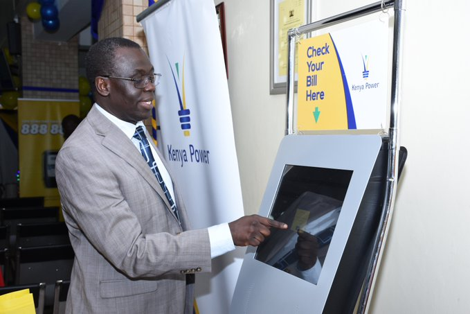 Ag. MD & CEO, Eng. Jared Othieno demonstrating how to use the Self Service Kiosk at Stima Plaza Banking Hall during Customer Service Week 2019.
