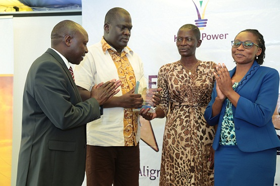 Eng. Moses Nyongesa holds his trophy moments after he won the Employee of the Year Award. Looking on is his wife, Managing Director & CEO Dr. Ken Tarus and the CEO of Kenya Association of Manufacturer