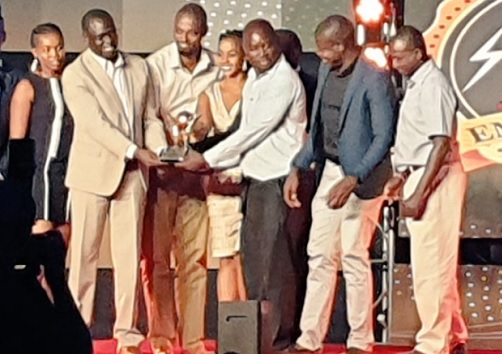 Ag. MD & CEO Eng.Jared Othieno Presenting an award to the Winners of Electricity savings award at Safari Park Hotel.