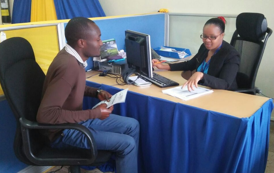 A Customer Service Officer attending to a customer at Stima Plaza Power Clinic.Kenya Power has launched new customer service centres dubbed 'Power Clinics' to improve service delivery and enhance cust