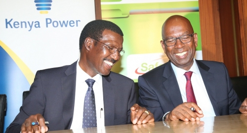 Dr. Chumo shares a light moment with safaricom CEO Bob Collymore during signing of M.O.U