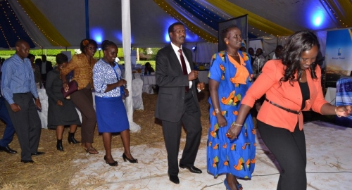Dr. Chumo accompanies other revellers during the excellence awards