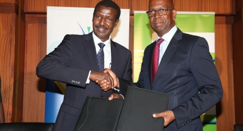 Kenya Power CEO Dr. Ben Chumo signs M.O.U with safaricom CEO Bob Collymore