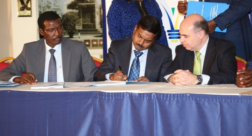 Kenya Power  MD & CEO, Dr. Ben Chumo (left),  Nelish Pimpalker (center) and Fernando Pablo of AEE Power (Spain)